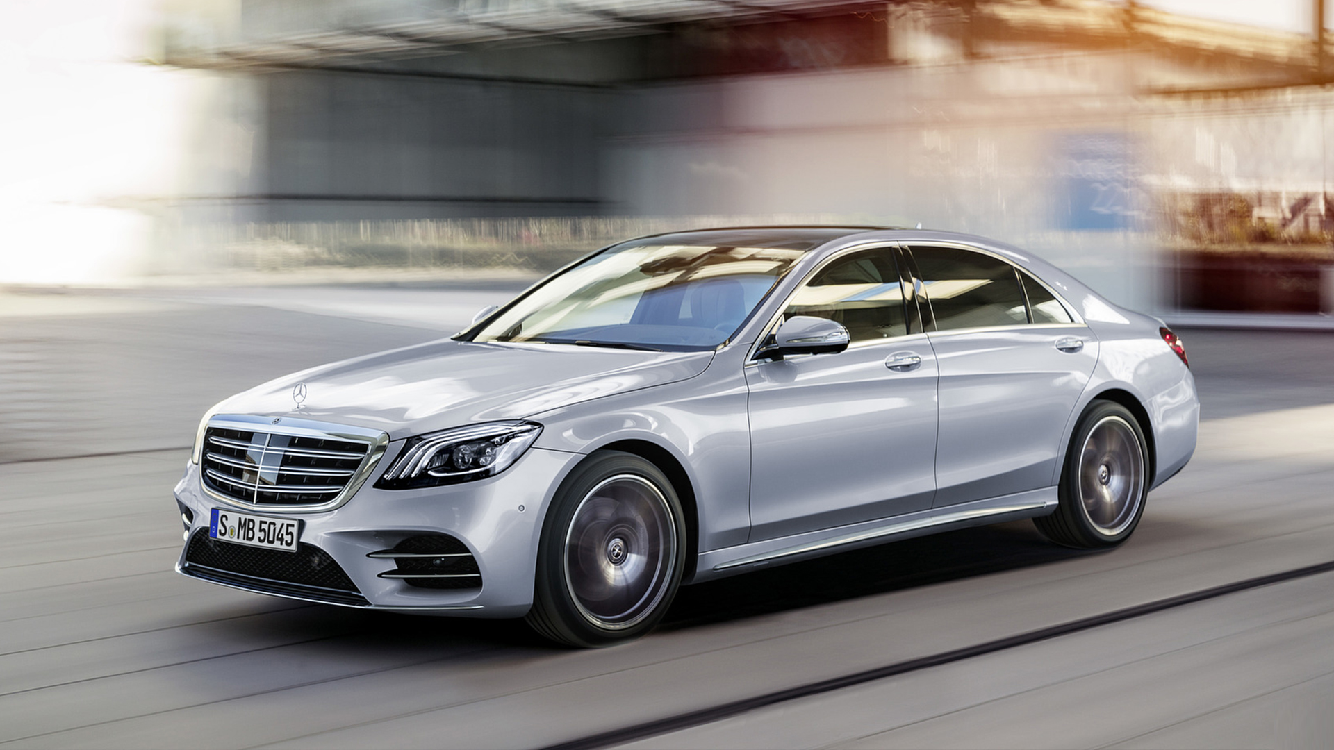 A Mercedes-Benz new company Lease car driving at speed with a distorted background